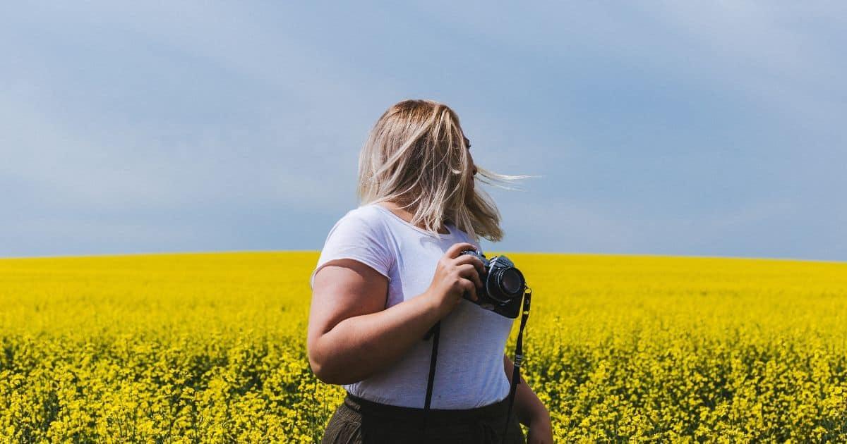 plus size woman taking photos
