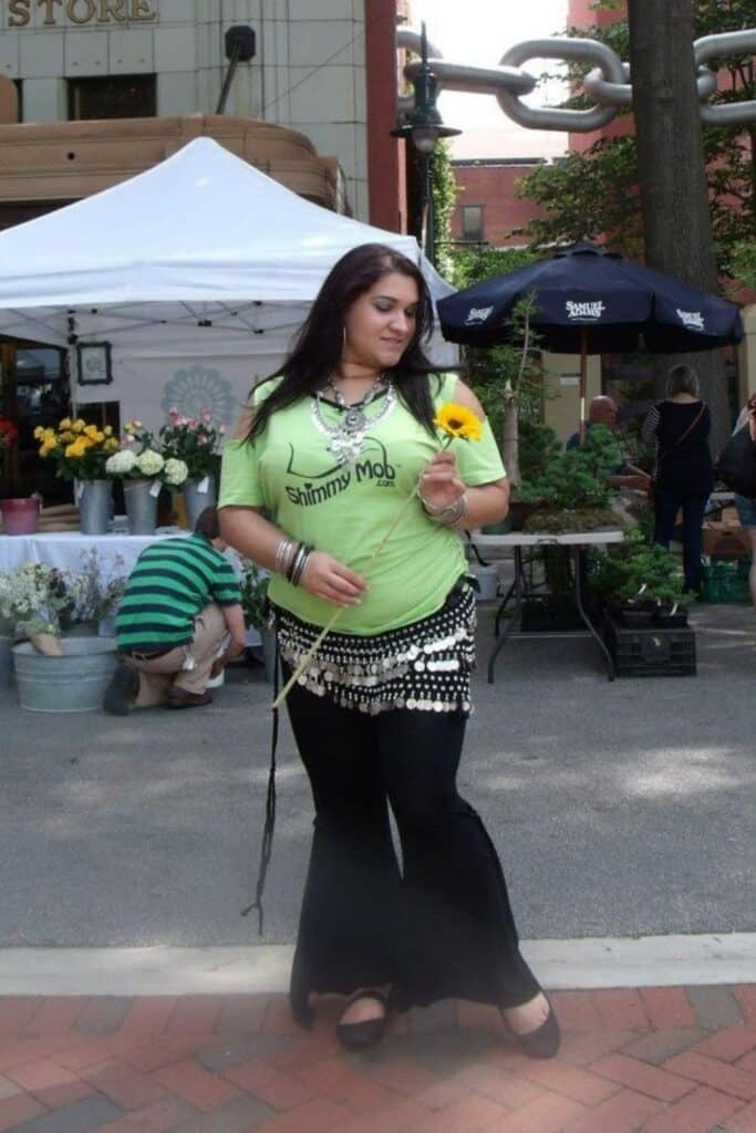 plus size pregnant belly dancing woman