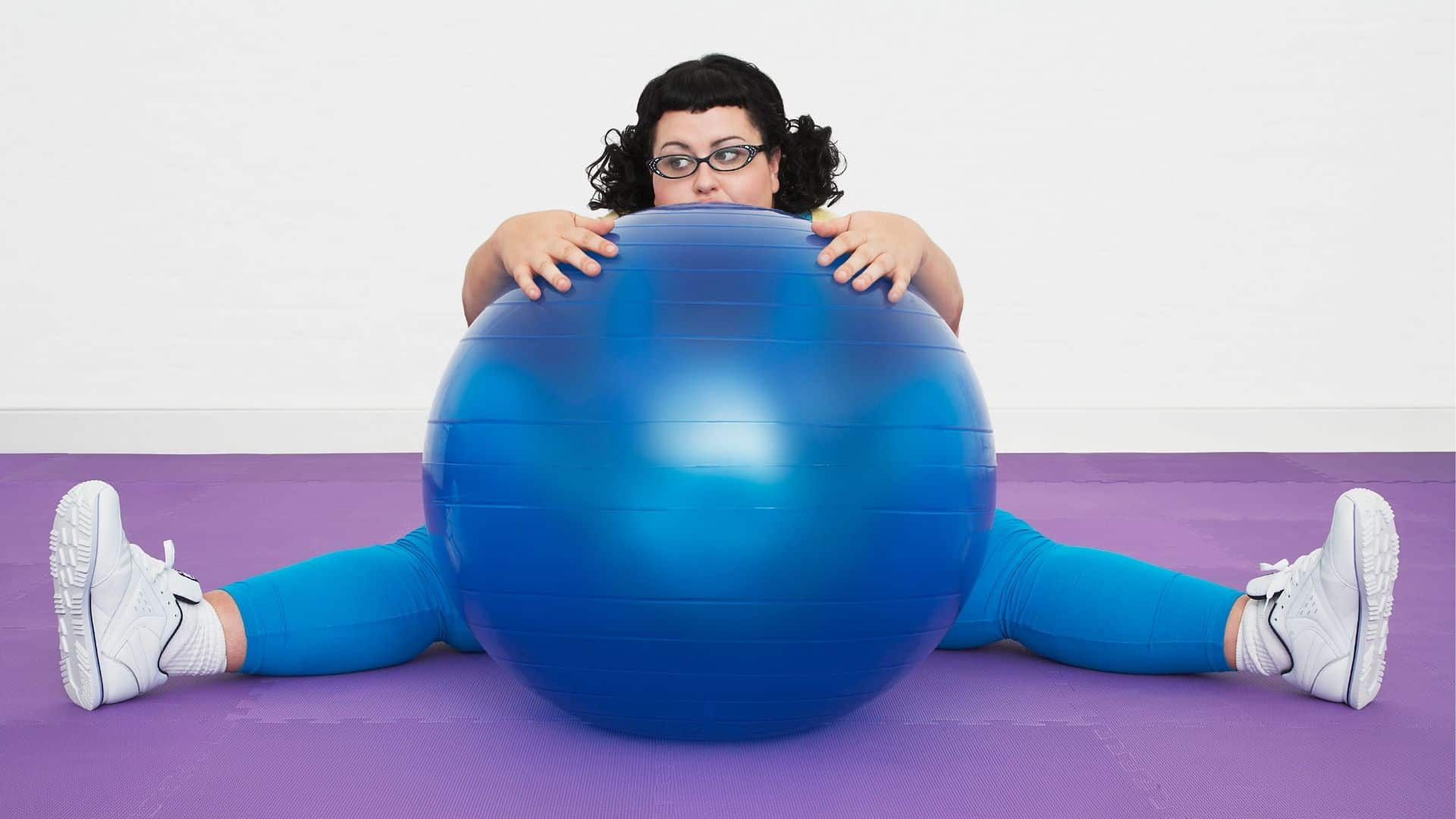 plus size woman at the gym with exercise ball