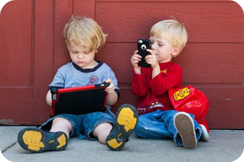 kids on tablet and phone
