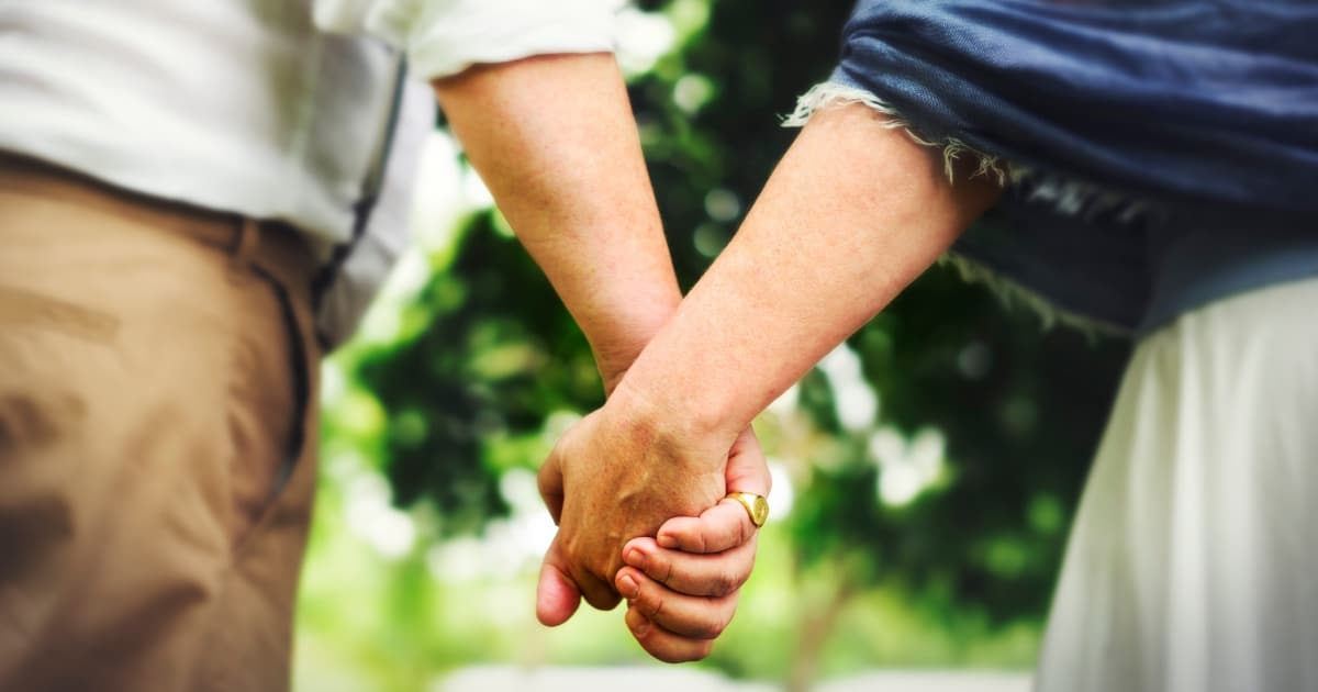 plus size couple holding hands
