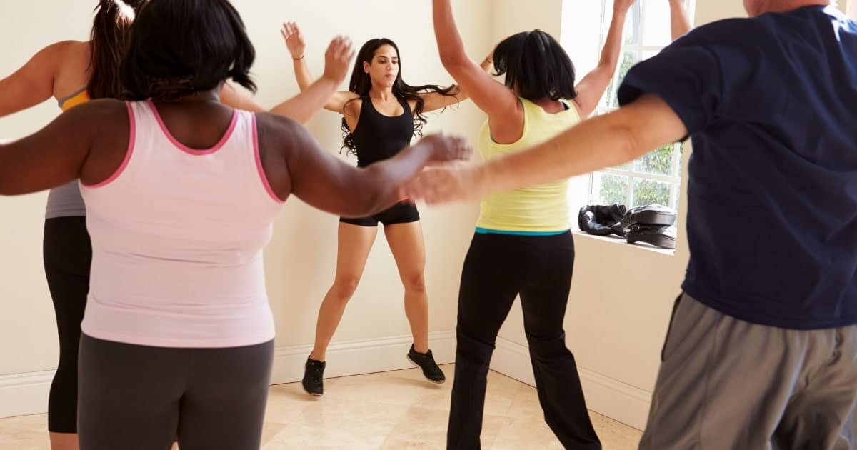 group of plus size people doing aerobics