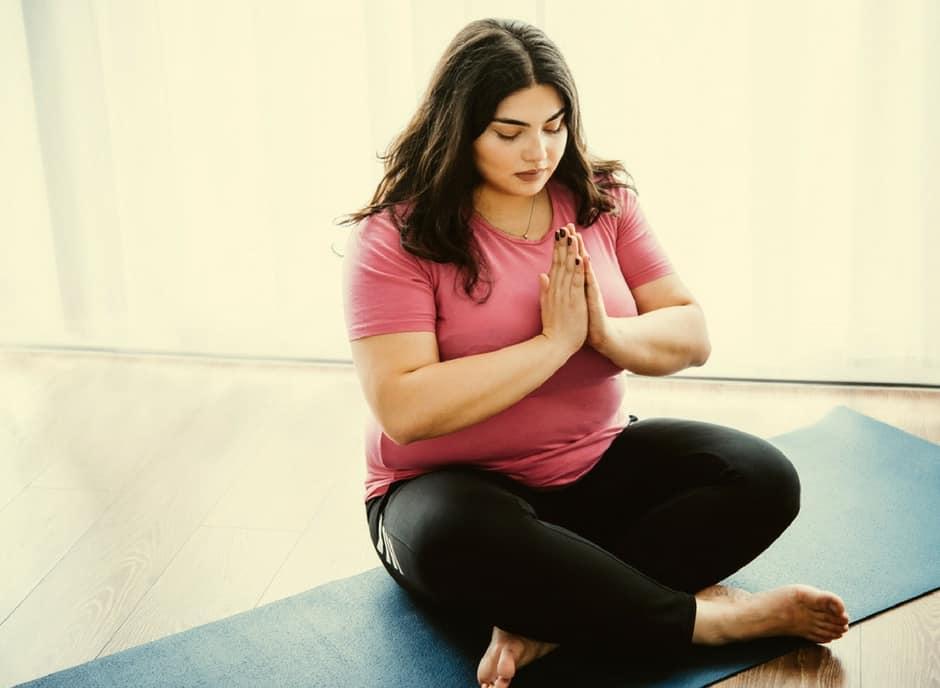 plus size woman doing yoga