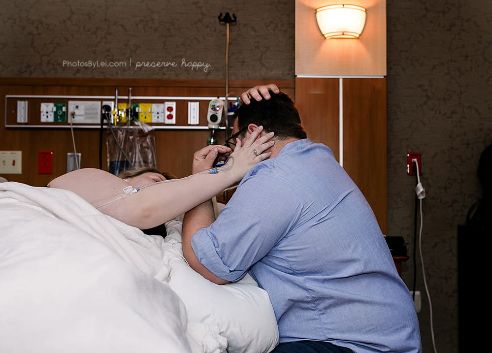couple supporting one another during childbirth