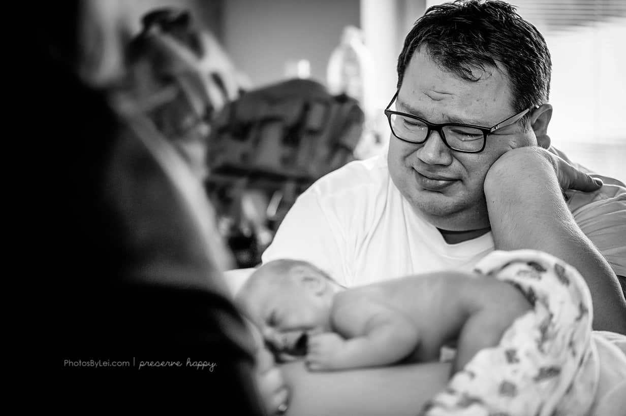 Dad looking newborn after birth