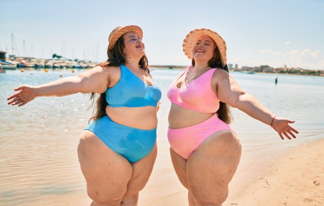 plus size twins on the beach with big thighs