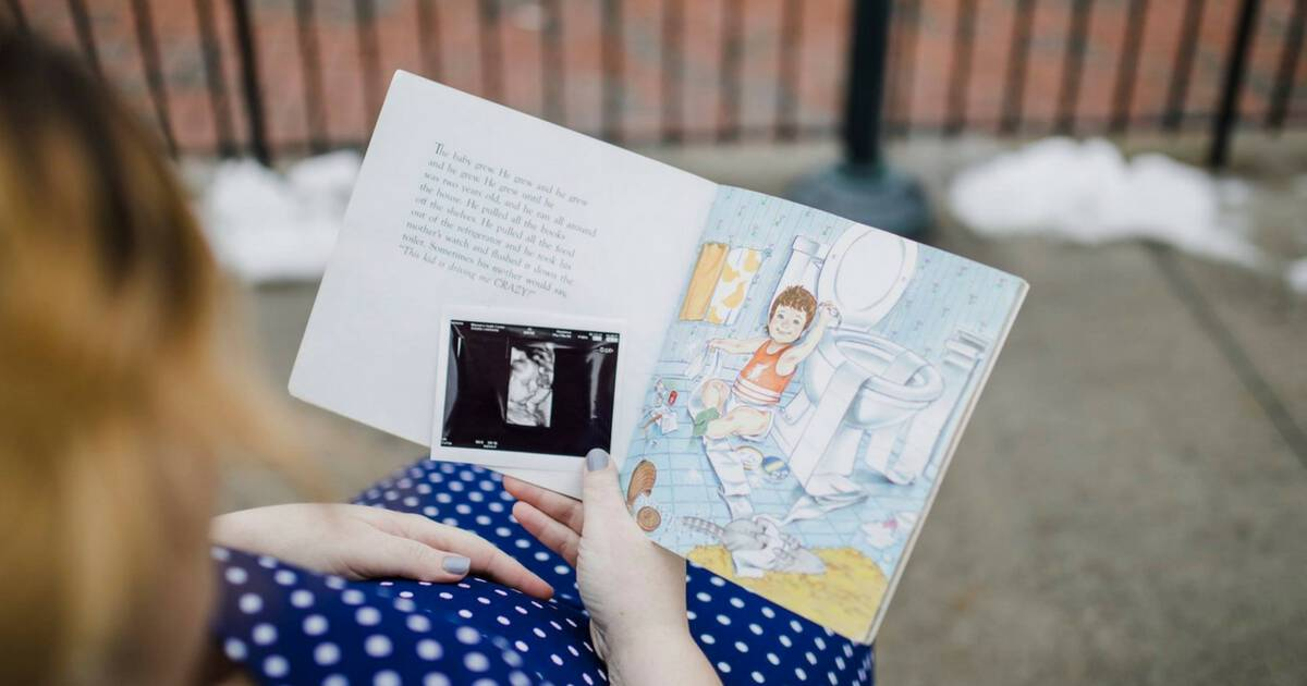 Mother reading I Love You Forever book with ultrasound