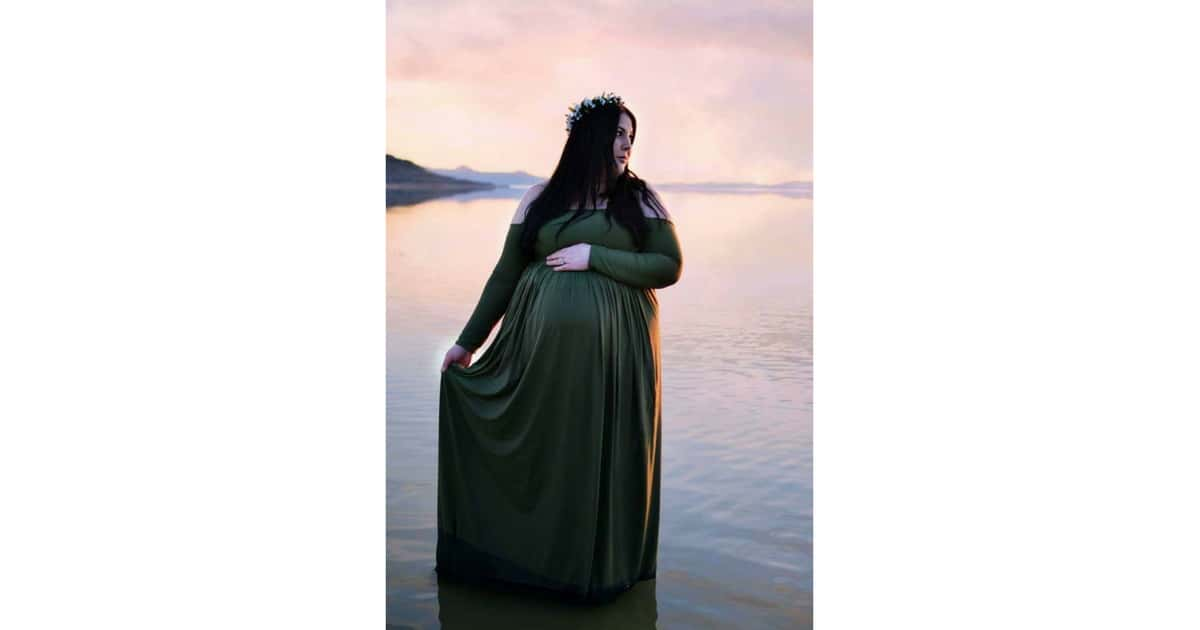 plus size pregnant woman standing in a lake