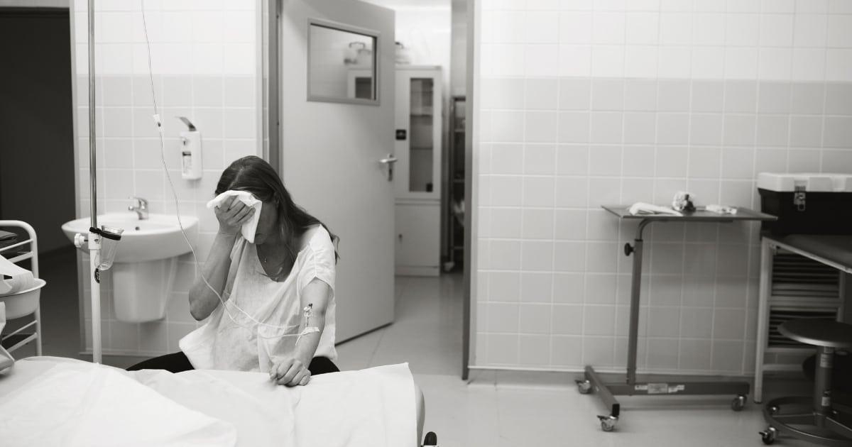 woman in hospital after having a stillbirth