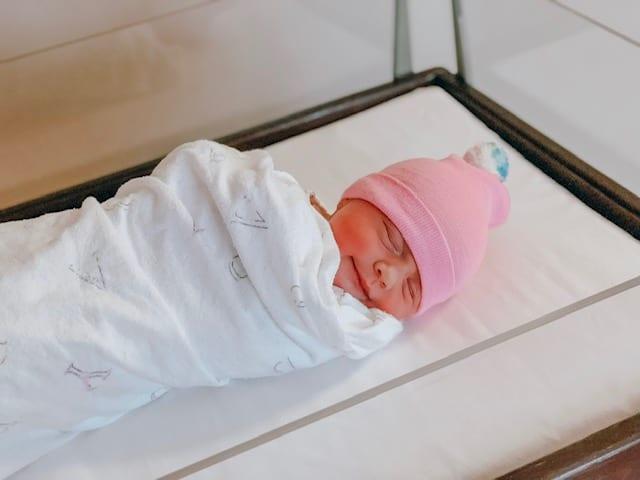 newborn smiling baby
