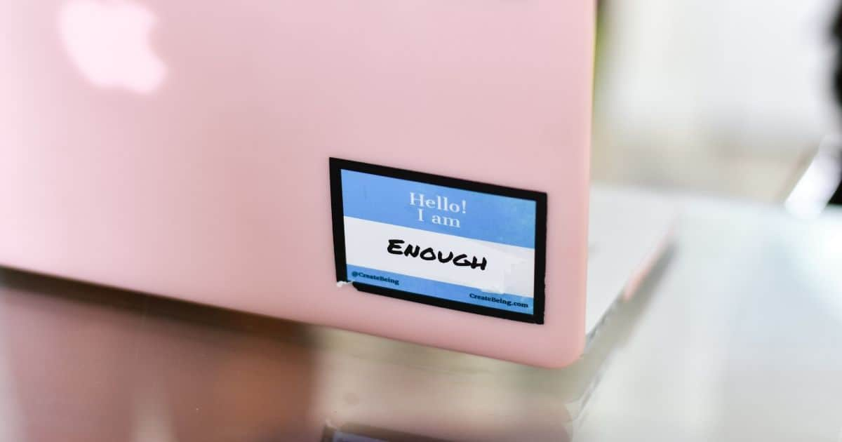 pink computer with sticker