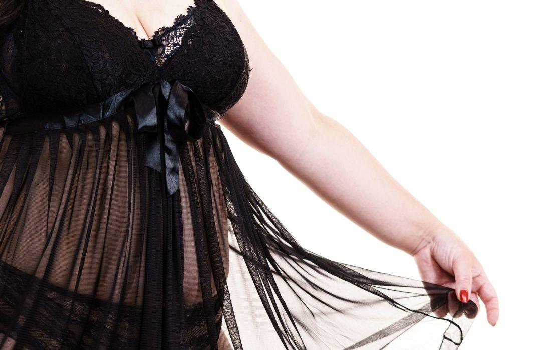 plus size woman wearing black lingerie