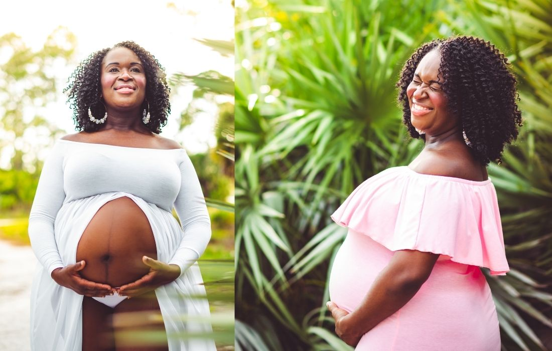 plus size woman wearing a white and pink plus size maternity dress for photoshoot
