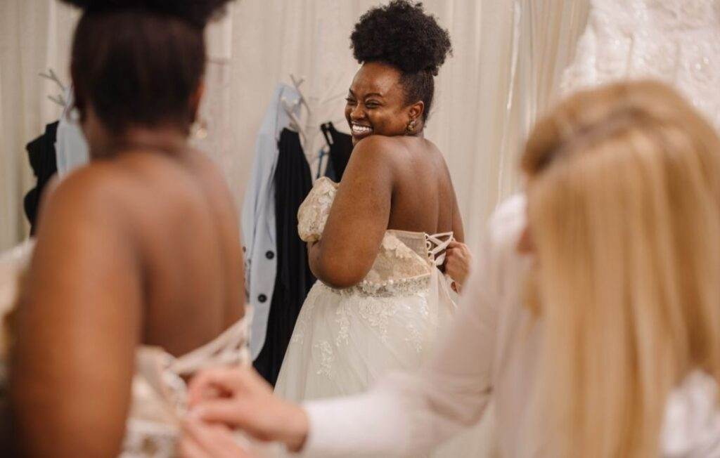 plus size pregnant woman wearing a plus size maternity wedding gown